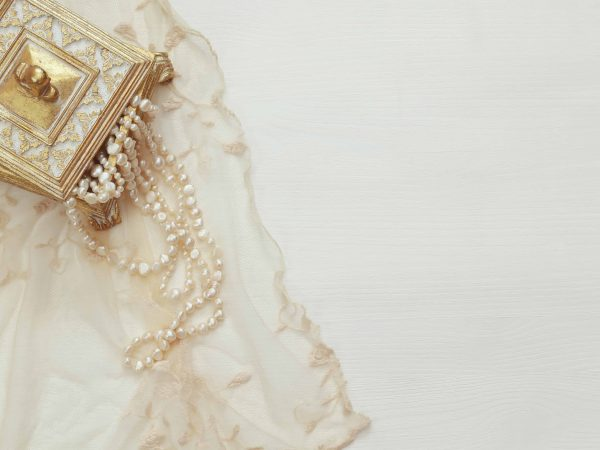 Top view image of white pearls necklace.
