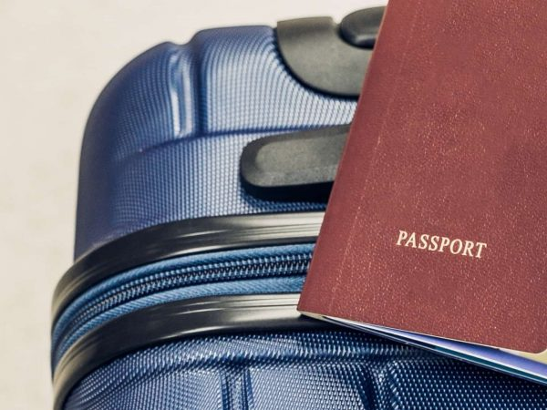 Close up passport and map lay on blue suitcase at airport,travel vacation concept.