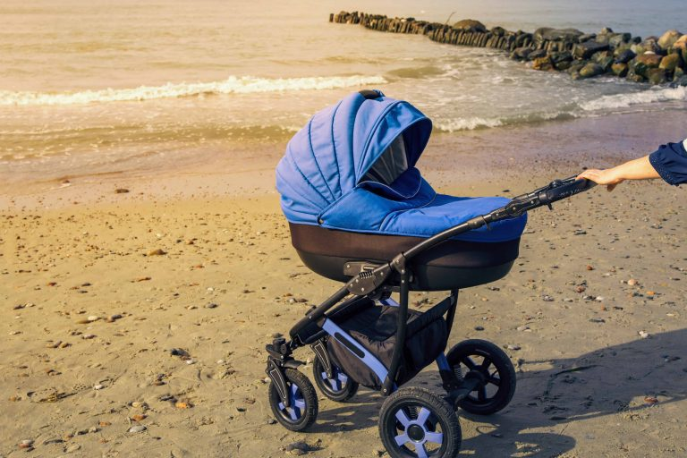 Riding baby stroller on the beach