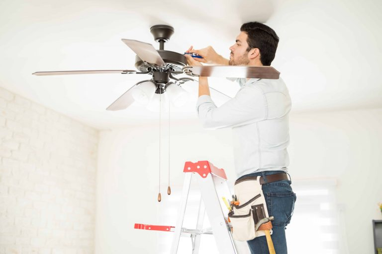 Man with a ceiling fan