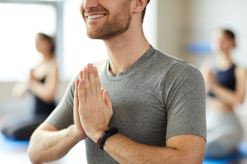 Man practicing yoga using smart band