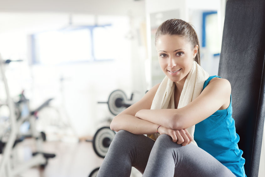Image of woman sitting in gym
