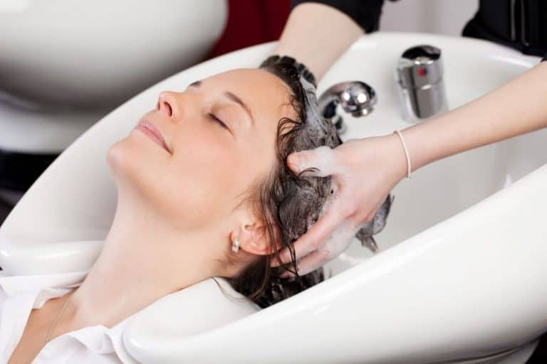girl relaxed washing her hair