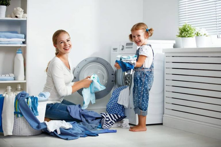 little girl and her mom doing the laundry