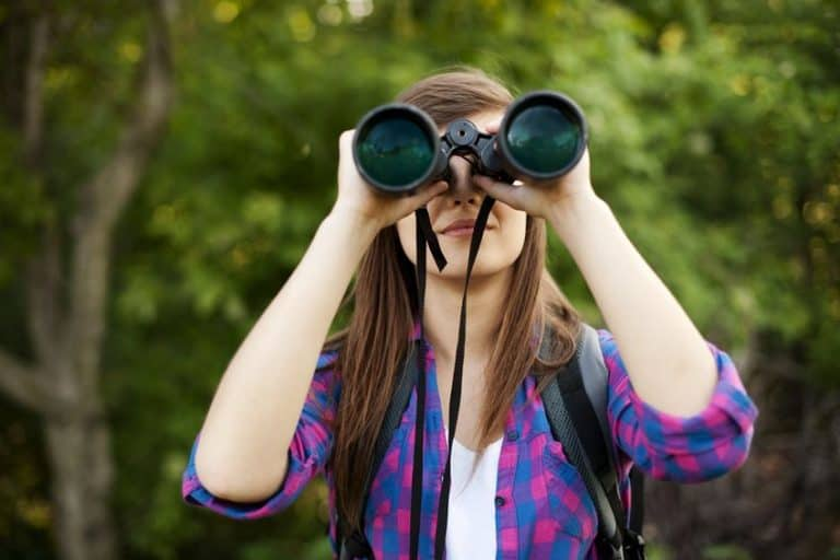Girl looking through to binoculars