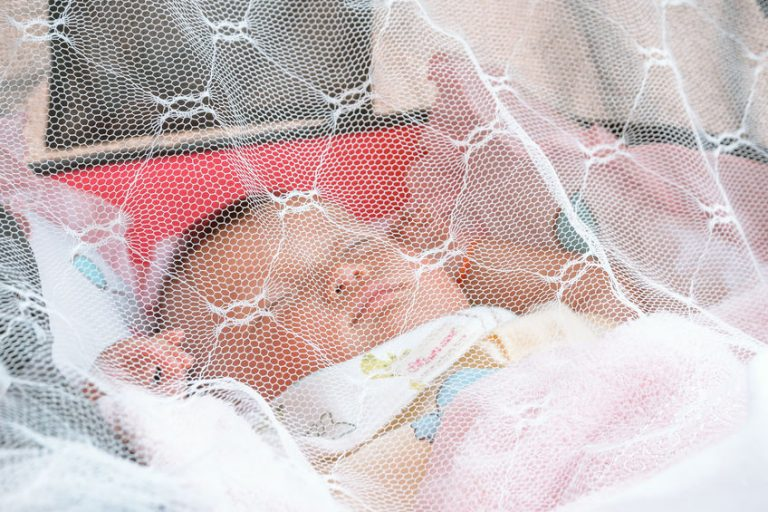 baby sleeping under a mosquito net (Shallow DOF)
