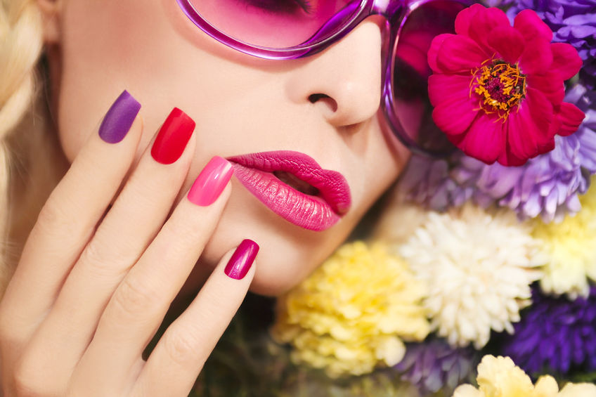 Woman with multi-colored nails