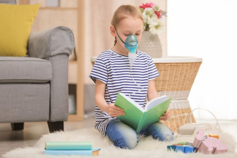 girl reading in a nebulizer therapy