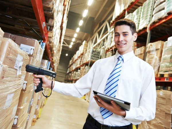 image of a person in the warehouse using a barcode scanner