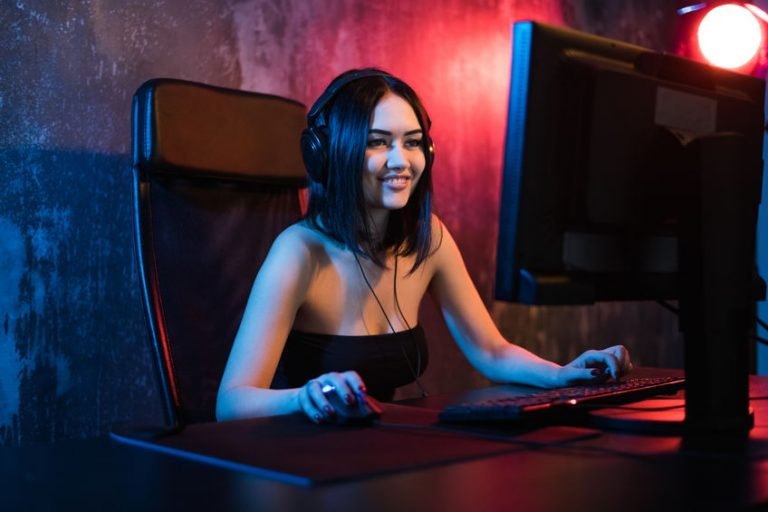 Woman sit on desk using PC with mousePad