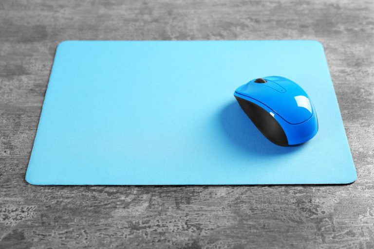 Mouse next to light blue mouse pad