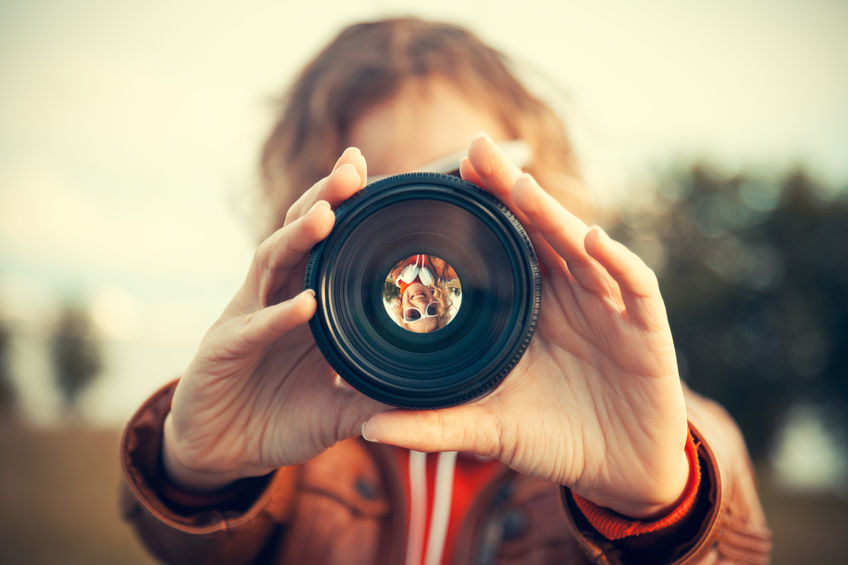 Image of person with a camera lens
