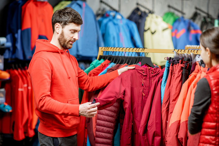 Man choosing winter clothes in the sports shop