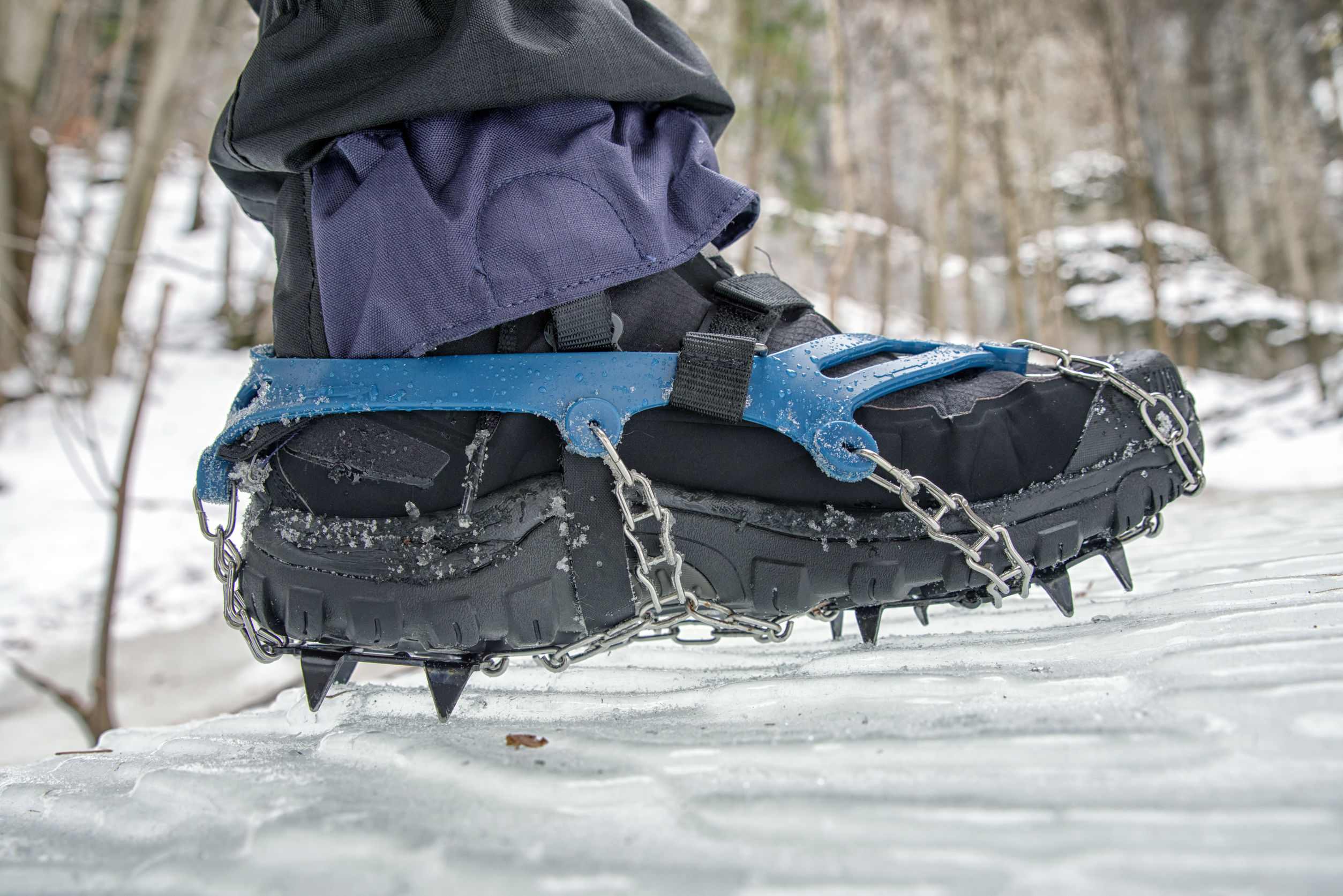 Crampons on black hiking boots